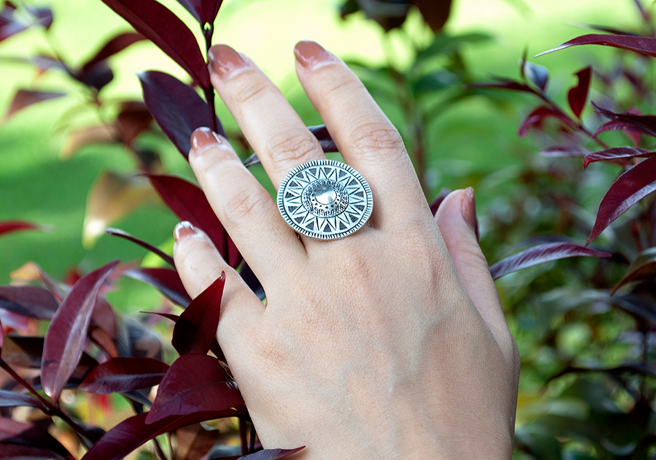 Model wearing boho ring with tribal patterns