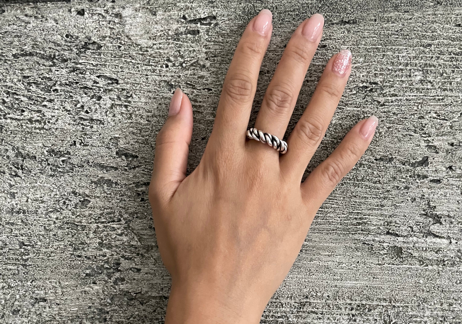 Model wearing thick twisted silver ring from Hill to Street