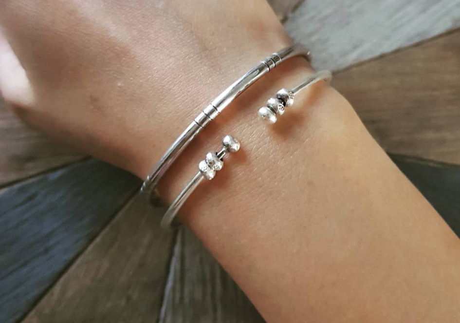 Stacking bracelets with minimalist silver bangles