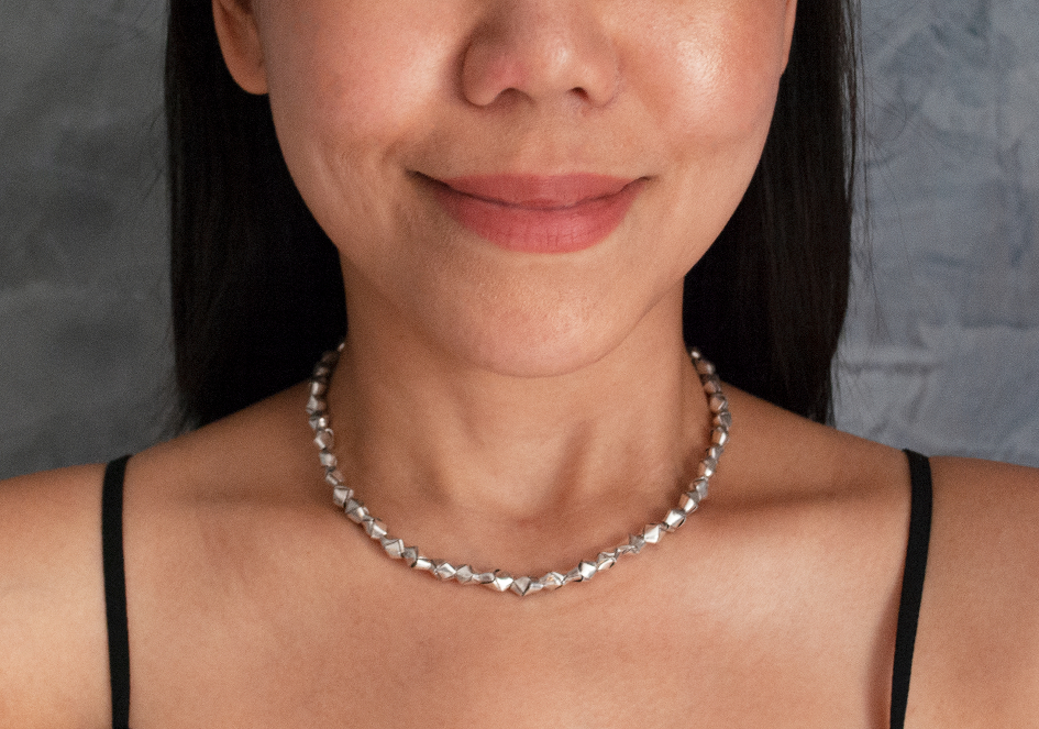 Model wearing unique silver beaded knot necklace from Hill to Street