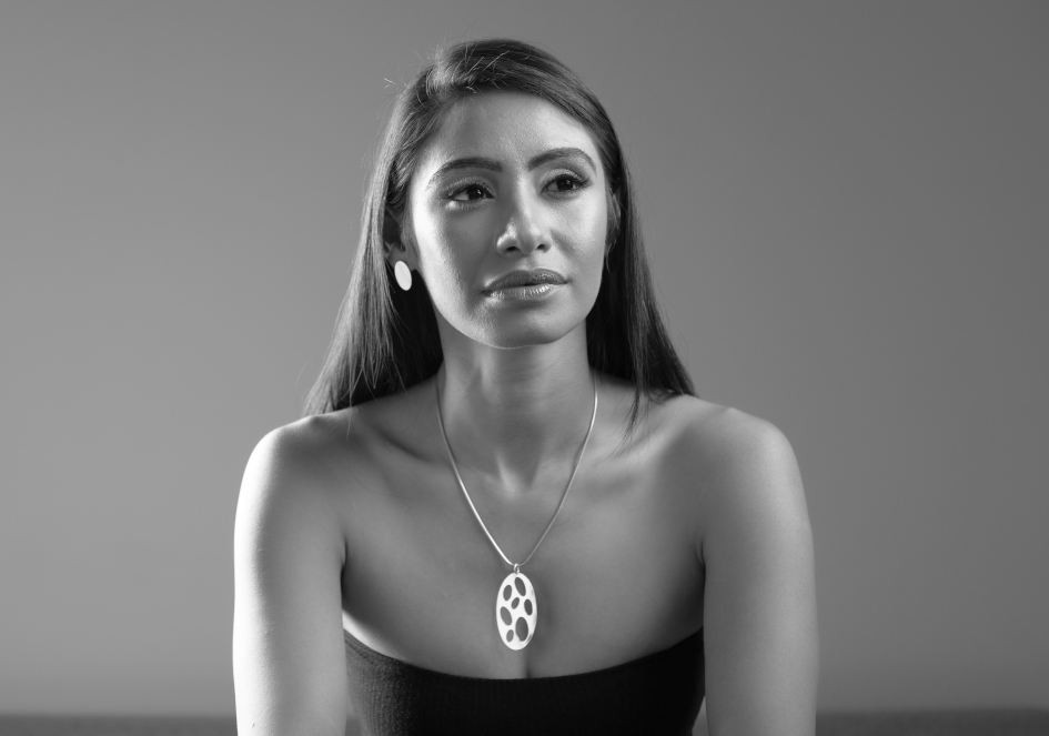 Model wearing oval cutout silver necklace by Hill to Street