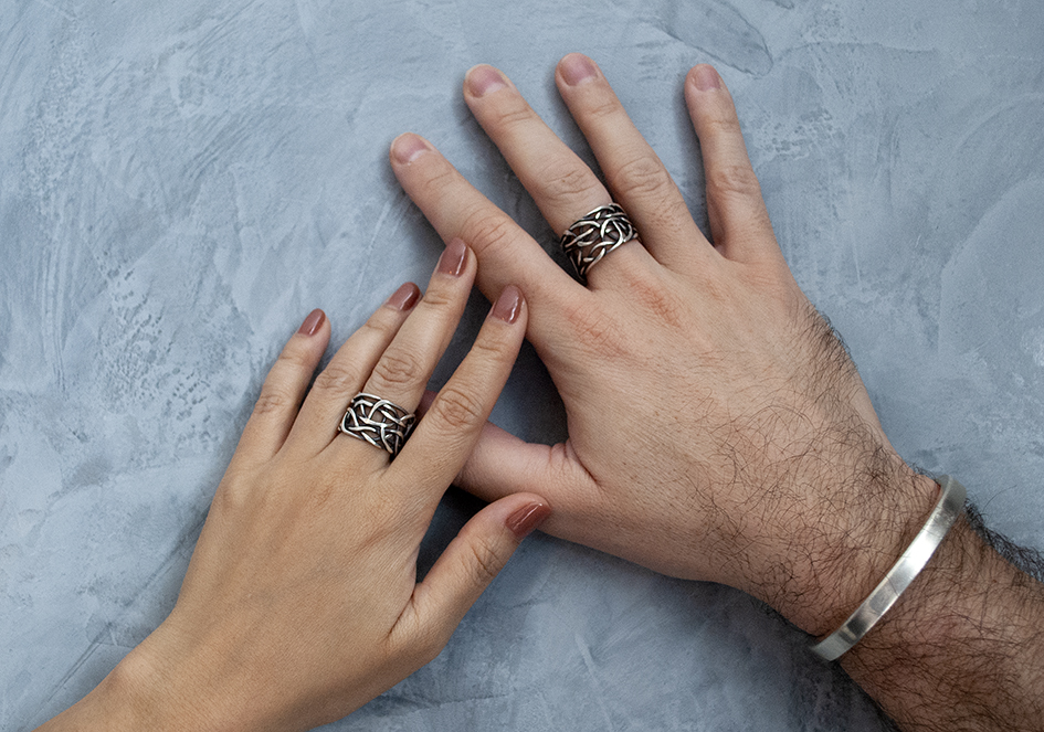 Couple wearing unisex messy woven silver rings