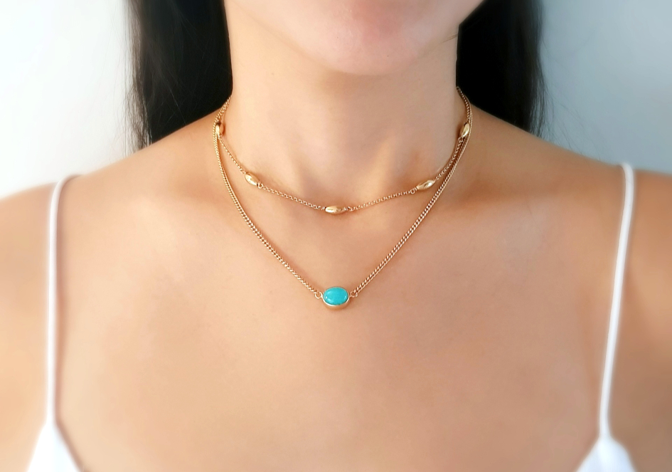 Model wearing layered gold plated sterling silver necklace set with Amazonite
