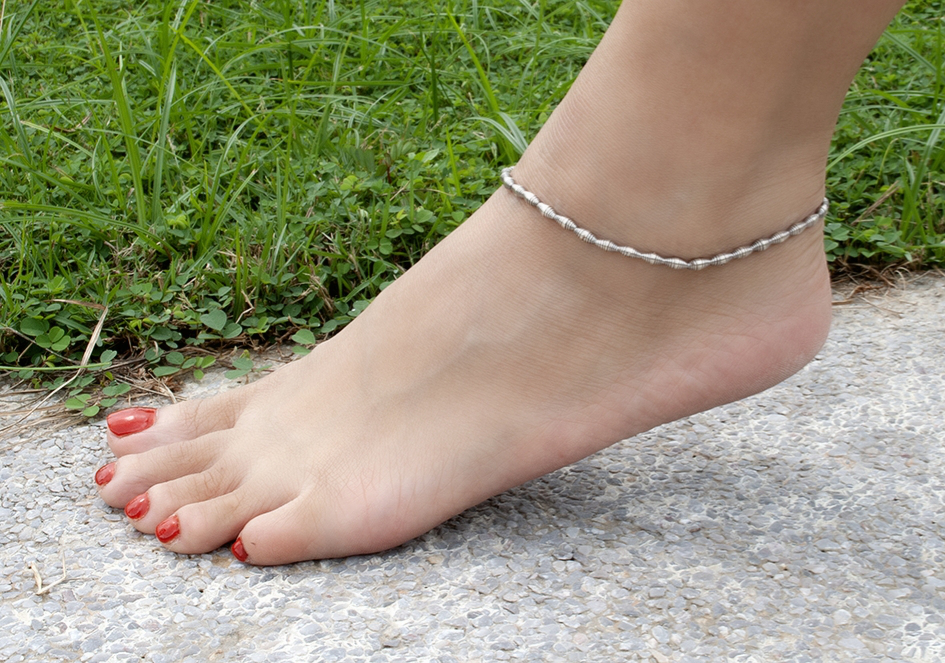 Model wearing rolled up silver beads anklet from Hill to Street