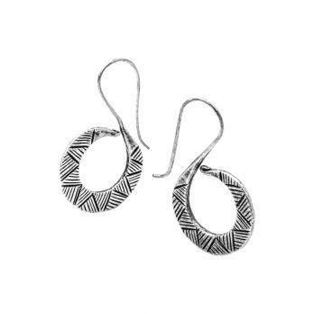 S-Shaped silver drop earrings with handcrafted tribal patterns