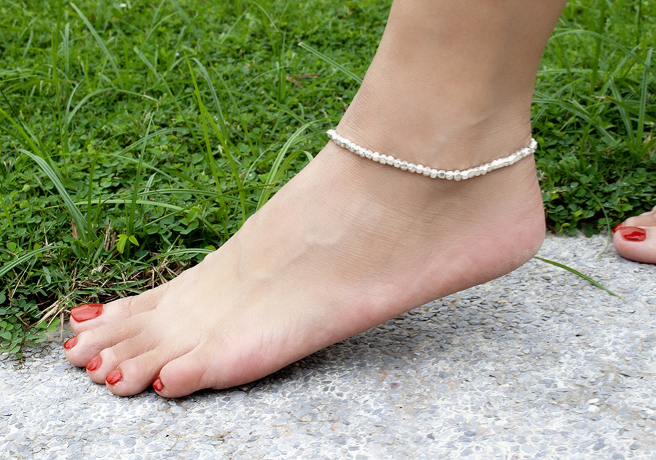 Model wearing square silver beads anklet