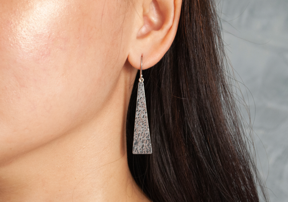 Model wearing sterling silver drop earrings