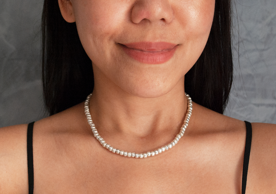 Model wearing silver beaded necklace by Hill to Street