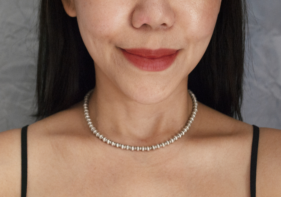 Model wearing silver beads necklace from Hill to Street