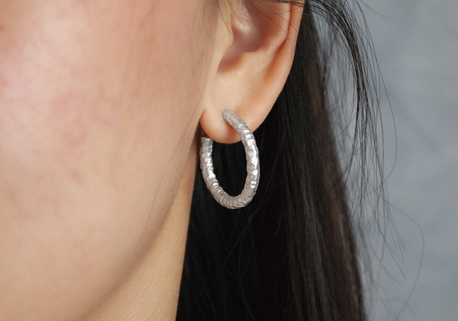 Model wearing small solid silver hoop earrings from Hill to Street