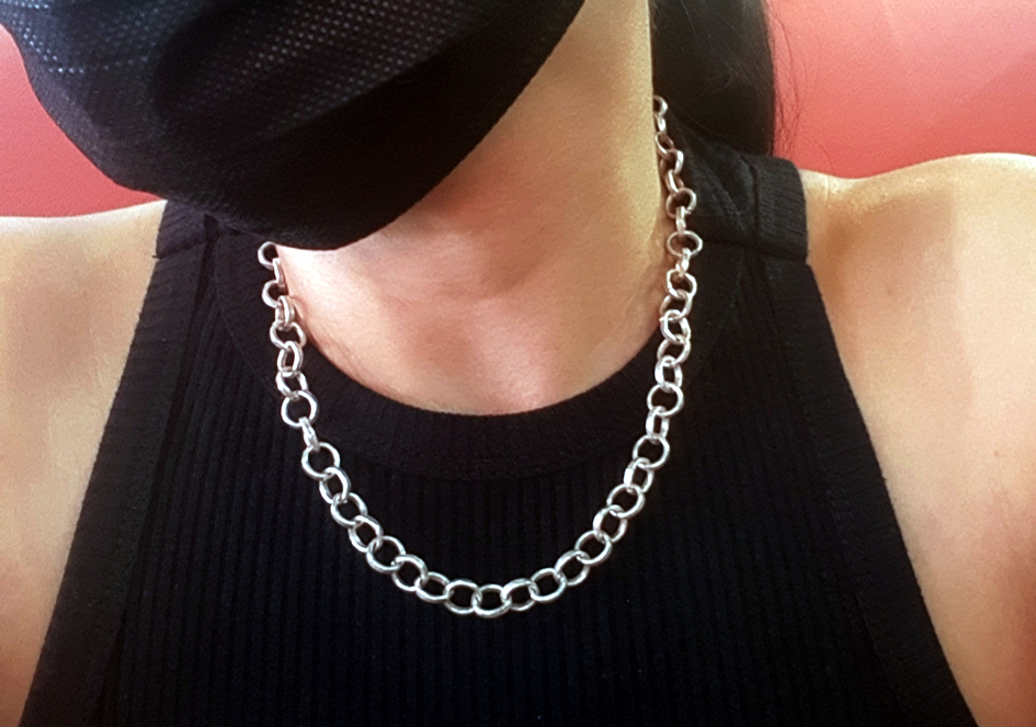 Model wearing hammered silver chain necklace from Hill to Street