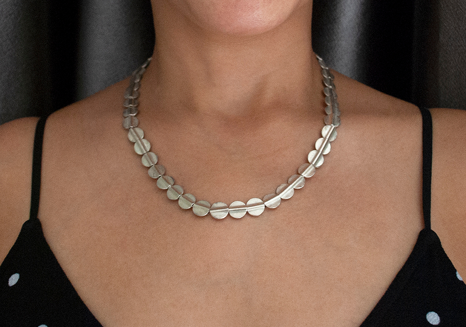 Model wearing short flat beads necklace from Hill to Street