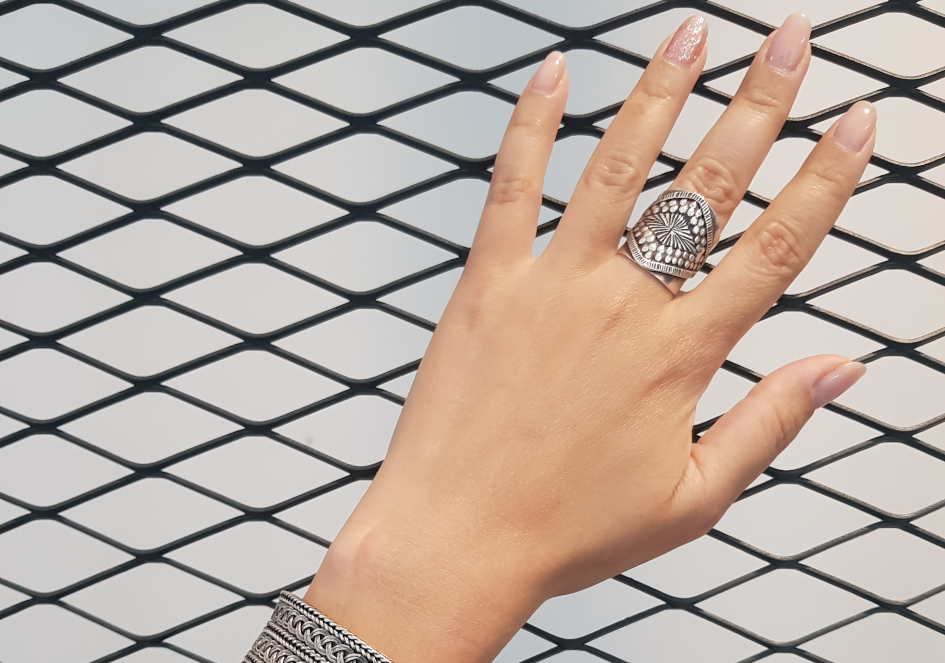 Model wearing stamped design silver cuff ring from Hill to Street